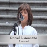 A screen capture from 9-year-old Daniel Bissonnette  during this past Saturday's March Against Monsanto in Vancouver. In this video of his speech, he defends organic farmers and lashes out at Monsanto.