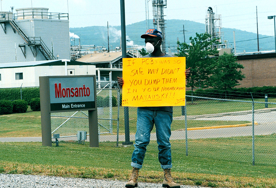 Activist Herman Frazier protests in front of a Monsanto Plant. Via The Anniston Star.