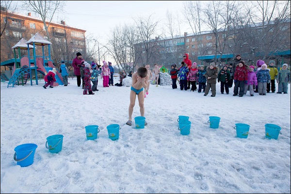 Siberian kids believe pouring a bucket of cold water in