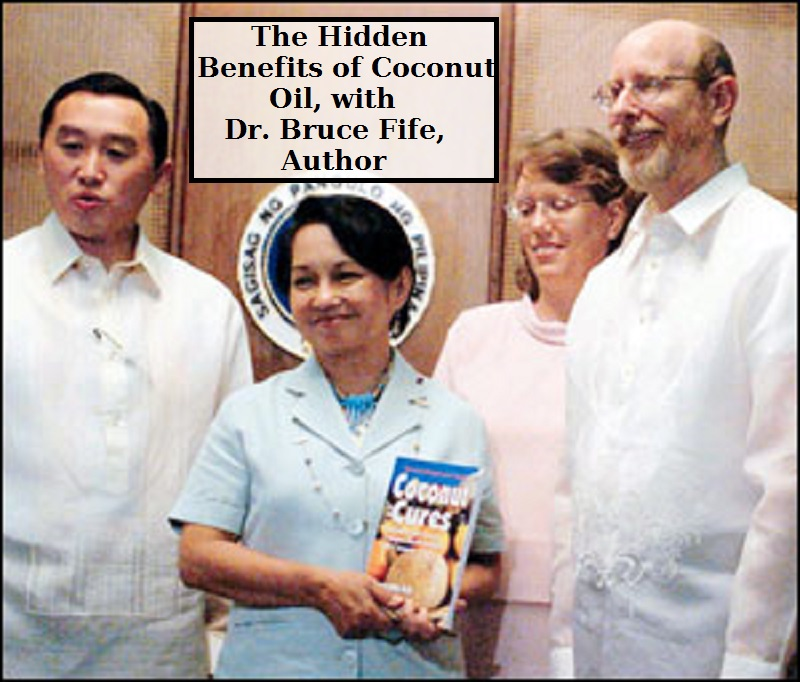 Dr. Bruce Fife presents a copy of his book on Coconut Oil cures.
