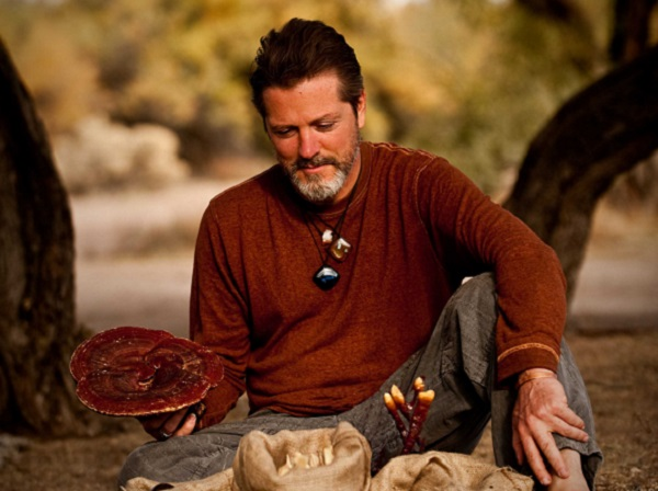 Rehmannia Dean Thomas with a gorgeous Reishi mushroom, one of his top 5 herbs.