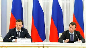 Russian Deputy PM Arkady Dvorkovich and PM Dmitry Medvedev (R).