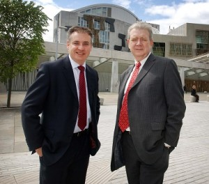Richard Lochhead (R) said that he did not want to gamble on GMO crops in Scotland.