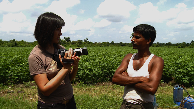 Journalist Leah Borromeo of the film 'Dirty White Gold' interviews an indebted Indian farmer. Via Vice.com.