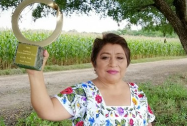 Leydy Pech with her award for stopping Monsanto